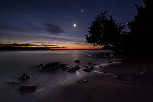 The Conjunction of Venus and Mars Beteen the Moon and Jupiter th by Jakub Sisak