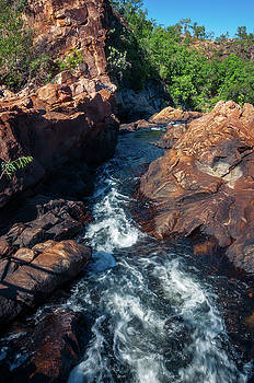 The creek flowing in between rocks at Edith Falls, Katherine, Au by Daniela Constantinescu