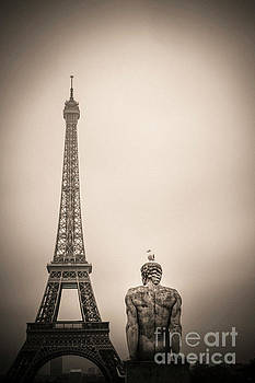 The Eiffel tower and the l'Homme the Man statue by Pierre Traverse Paris. France. Europe. by Bernard Jaubert