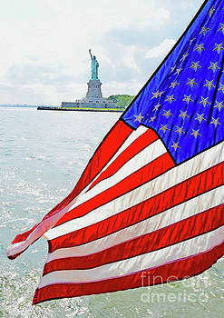 The Flag Flies For The Statue of Liberty by Tom Wurl