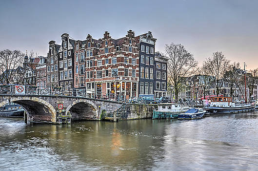 The Lights go on in Amsterdam by Frans Blok