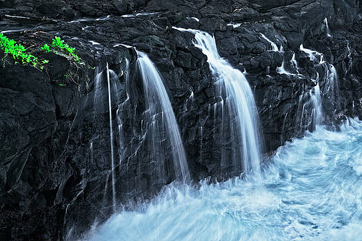 The Lower Queen's Bath Falls pours into the Pacific Ocean. by Larry Geddis