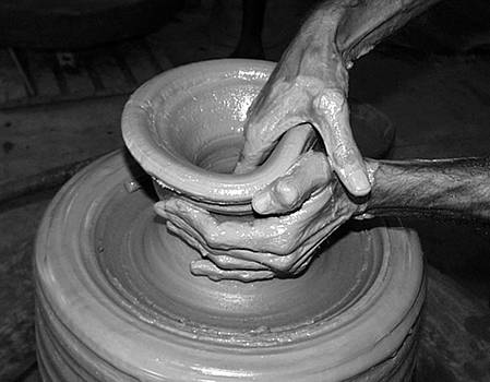 The magical hands of a potter by Arvind T Akki