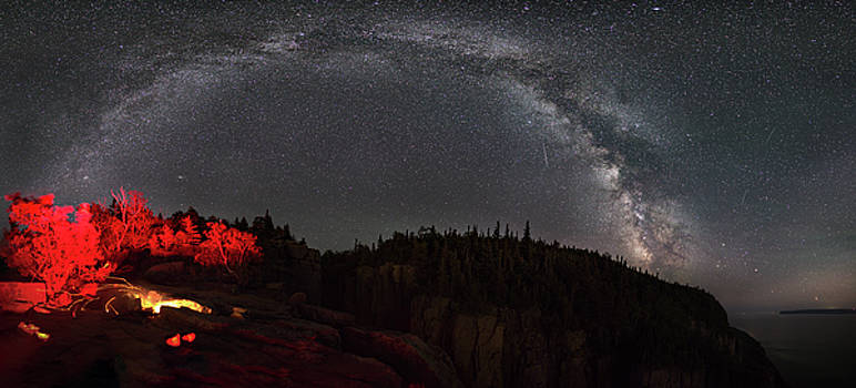 The MIlky Way Arch over a campifire atop the Chimney by Jakub Sisak