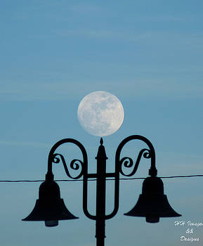 The Moon Touching the Lamp by Heather Huffman