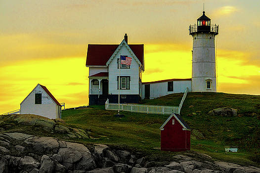 Chris Lord - The Nubble Cape Neddick Lighthouse in Maine At Dawn