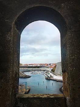 The Port of Angra do Heroismo from a window in Forte de Sao Sebastiao by Kelly Hazel