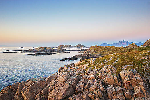 The rocky coast of the North Atlantic near Hovden on island  Langoya at sunset by Kunst and Scheidulin