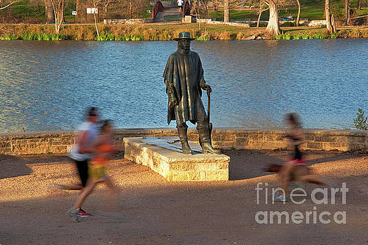 Herronstock Prints - The Stevie Ray Vaughan Memorial Statue greets joggers and runners as they zoom by the Lady Bird Lake Hike and Bike Trail