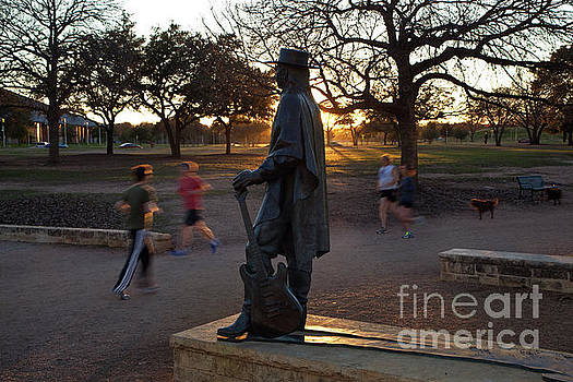 Herronstock Prints - The Stevie Ray Vaughan Statue in Austin is an inspirationon the Lady Bird Lake Hike and Bike Trail