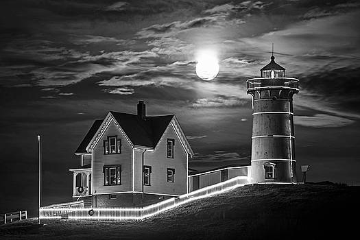 The supermoon rising over the Nubble Lighthouse York Maine Black and White by Toby McGuire