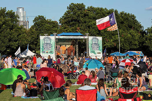 Herronstock Prints - The Texas flag flies in the hot summer breeze at Austins Blues on the Green, a favorite summer concert tradition in Austin