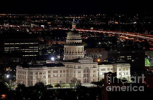 Herronstock Prints - The Texas State Capitol at night as rush hour traffic lights streak along Interstate I-35