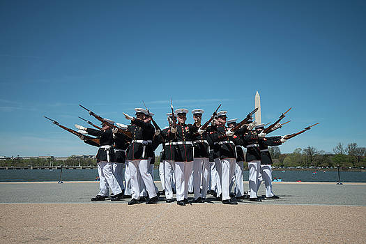 The US Marine Corps Silent Drill Platoon competes during the joint service drill team  by Paul Fearn