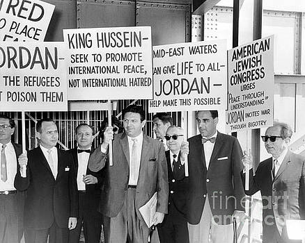 Theodore Bikel and Dr. Joachim Prinz along with a group of pickets showed up to a fair in 1964. by William Jacobellis