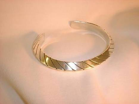 This Heavy Gauge Triangular Silver Bracelet Is Offered In Three Sizes by Eddie Romero