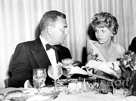 Thomas E. Dewey with Mrs. Abba Eban in the delegate's dining room United Nations in 1959. by Anthony Calvacca