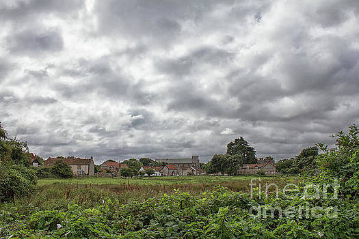 Thornham village under a leaden sky by John Edwards