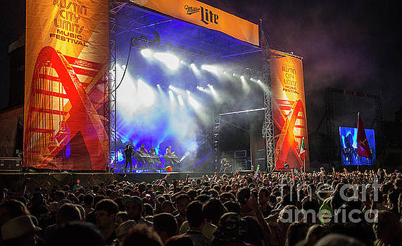 Herronstock Prints - Thousands of concert goers at the ACL Austin City Limits outdoor music festival are greated by a state of the art light shows and mammoth stages
