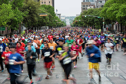 Herronstock Prints - Thousands of runners keep a fast pace racing up Congress Avenue during the annual Capitol 10K Race