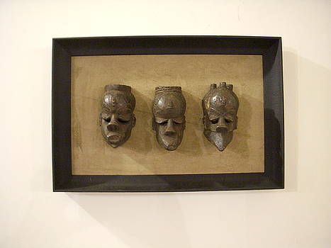 Three African Masks in shadow box  by None