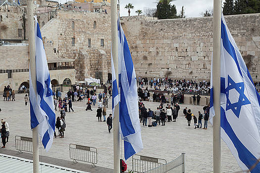 Three flags of Israel with the wailing wall in the background by Yoel Koskas