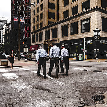 Three men crossing street. St. Louis street photography by Dylan Murphy