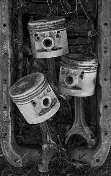 Three Pistons In A Pan by Paul DeRocker