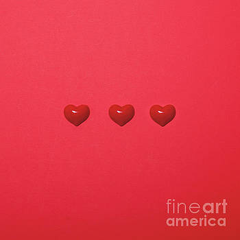Three small hearts on red background - Minimal design by Aleksandar Mijatovic