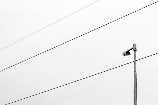Three Wires and a Street Lamp by Prakash Ghai
