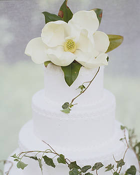 Tiered Wedding Cake With Flower On Top by Gillham Studios