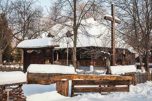 Timber cottage covered in snow at the Village Museum, Bucharest by Daniela Constantinescu