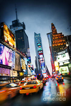 Times Square in the rain, New York by Justin Foulkes