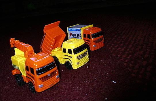 Tiny Trucks by Maina  Kabiru