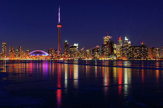 Reimar Gaertner - Toronto city skyline lights at night reflected on the frozen ice