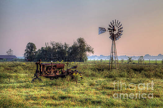Larry Braun - Tractor by a Windmill