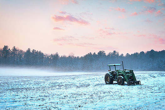Tractor in a snowy field Durham NH by Eric Gendron