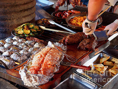 Traditional Chilean barbecue or asado in Patagonia by Louise Heusinkveld