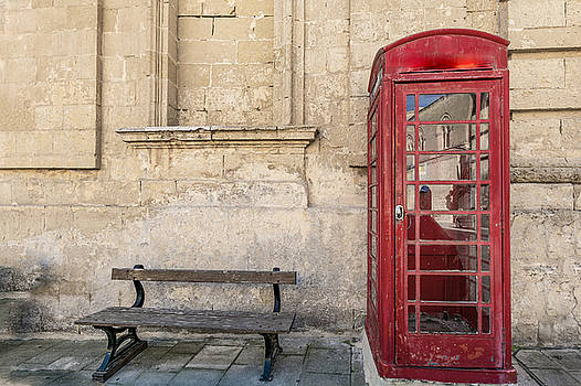 Traditional red phone boot and wooden bench by Julian Popov