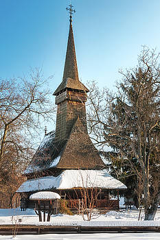 Traditional Romanian wooden Church covered in snow  by Daniela Constantinescu