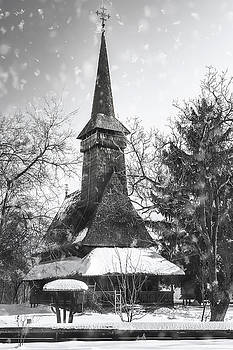 Traditional Romanian wooden Church covered in snow in black and  by Daniela Constantinescu