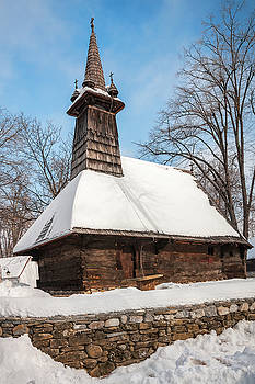 Traditional wooden church covered in snow by Daniela Constantinescu