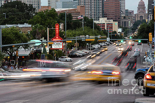 Herronstock Prints - Traffic shoots up and down South Congress Avenue, a popular shopping district always packed with tourists and locals alike