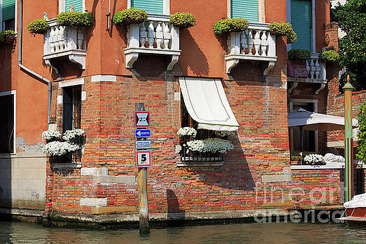 Traffic signs on the canal in Venice Italy by Louise Heusinkveld