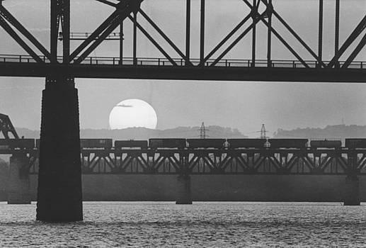 Train on bridge by Jim Wright