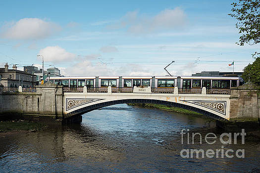 Tram on the Sean Heuston Bridge by Andrew Michael