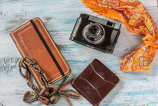 Travel concept,with old camera,wallet and book by Julian Popov
