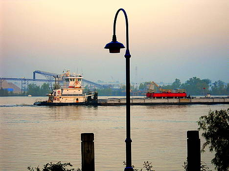Tug Boat on the Mississippi by Ted Hebbler
