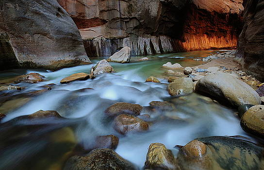 Tunnel light through the Narrows at Zion National Park by Jetson Nguyen