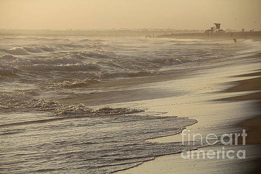 Turbulent Seas Sunset Beach by Linda Queally